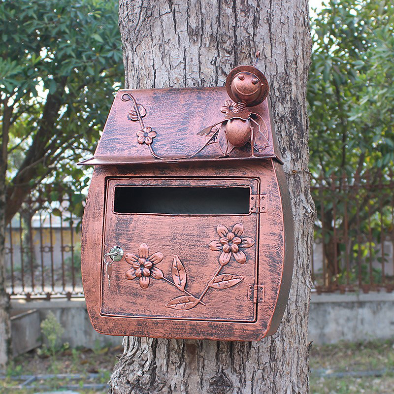 outdoor vintage metal mailbox on wall