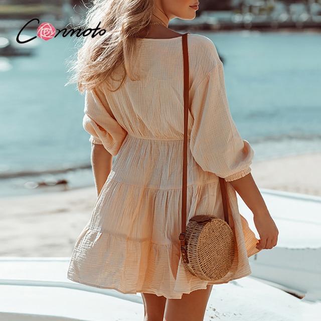 Conmoto Sexy deep v-neck bubble sleeves dress Elegant button elastic waist woman dress Pure color summer short dress 2021 new 6