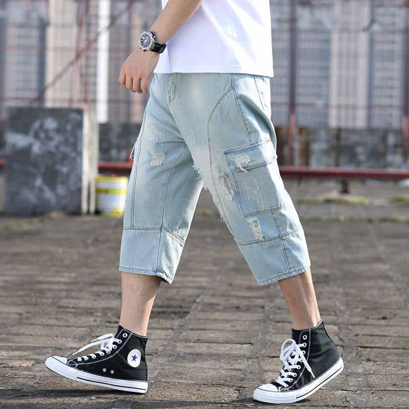 Lato w stylu japońskim sprane dżinsy spodnie do łydki mężczyźni główna ulica luźna Plus rozmiar 42 z dziurami wiele kieszeni dżinsy Harem Pants