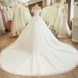 Image 2 - SL 5054 księżniczka próbka suknia ślubna gorset suknia z ramienia z krótkim rękawem koronkowy pas tanie suknia ślubna chiny