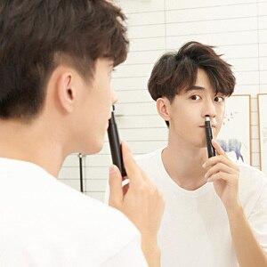 Image 1 - XiaomiMijia ShowSee Mini Portable électrique hommes nez tondeuse amovible lavable Double tranchant 360 tête de coupe rotative