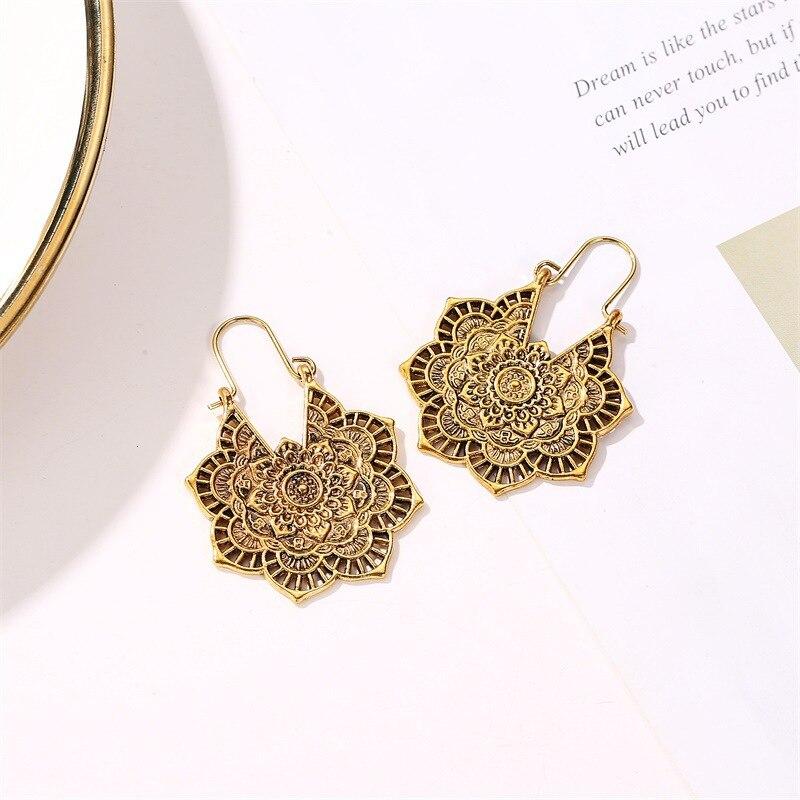 Boucles d'oreilles exotique vintage métal ajouré fleur boucles d'oreilles bohème sculpté palace vent boucles d'oreilles 4