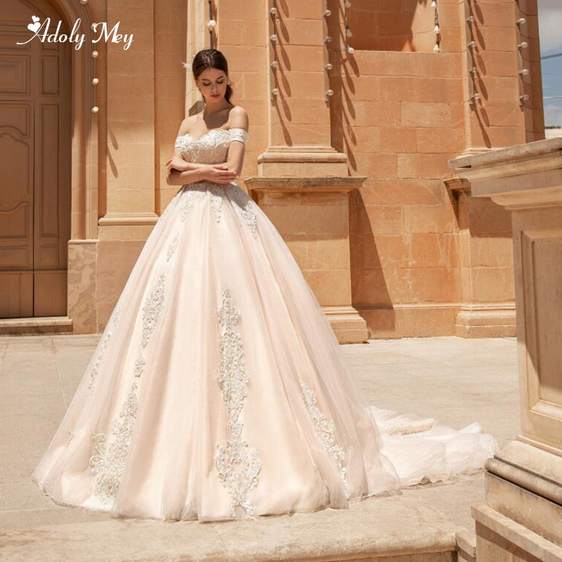Adoly Mey Charming Boat Neck Lace Up A-Line Wedding Dress 2020 Luxury Beaded Appliques Court Train Vintage Bride Gown Plus Size