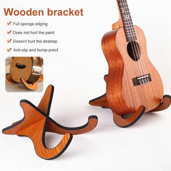 Portable Ukulele Wooden Foldable Holder Stand Collapsible Vertical Guitar Guitar Bass Violin Display Stand Rack Accessories vintage tower type guitar metronome bell ring rhythm mechanical pendulum metronome for guitar bass piano violin accessories