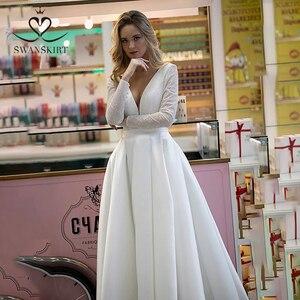 Image 1 - Prachtige Satijn Trouwjurk Swanskirt HZ32 Eenvoudige V hals Lange Mouw A lijn Prinses Bruidsjurk Aangepaste Vestido De Novia