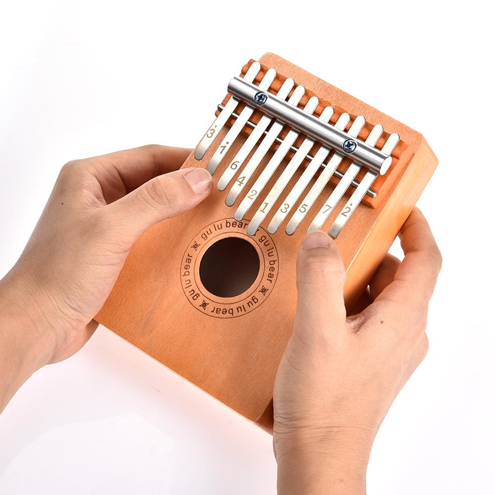 10 Tasten Red Wood Kalimba Thumb Piano Traditionelles Musikinstrument TH1273