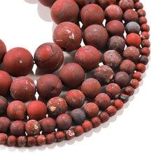 Круглые бусины из матового натурального камня красные россыпью