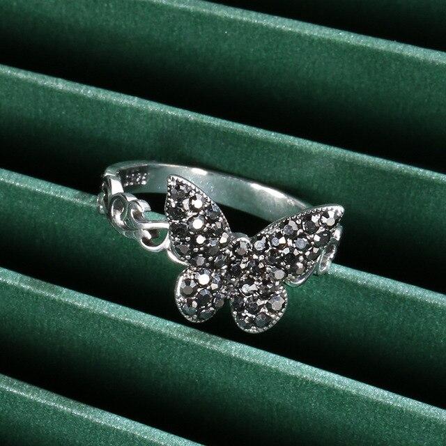 винтажное тибетское серебряное черное кольцо с бабочкой из фианита фотография