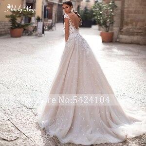 Image 2 - Adoly Mey Romantic Scoop Neck Backless A Line Wedding Dress 2020  Cap Sleeve Appliques Brush Train Princess Bride Gown Plus Size