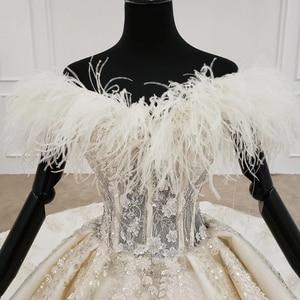 Image 4 - HTL1248 王女のウェディングドレス 2020 毛皮の襟縫製ビーズ上レーススカート背中自由奔放に生きるウェディングロングスリーブ vestido デ noiva
