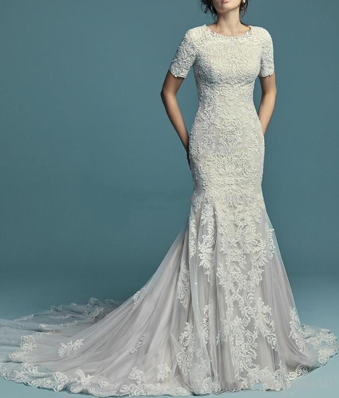 Nouvelles Appliques de dentelle sirène robes de mariée modestes avec demi manches courtes col rond boutons dos robes de mariée sur mesure