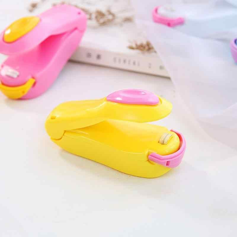 Empat Warna Portable Mini Mesin Rumah Tangga Mesin Mesin Makanan Pelindung Plastik Kemasan Mini Gadget