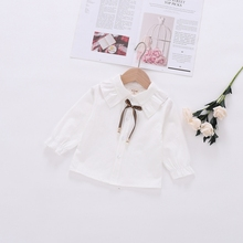 цена на DAILOU Korean Style Kids White Blouse Spring Children's Long-sleeved Girl Shirts Solid Color Lace Bow Tie Toddler Girl Blouse
