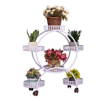 A Living Room Belt Wheel Storage Shelves Iron Art Indoor Balcony Landing Type Flowerpot Frame