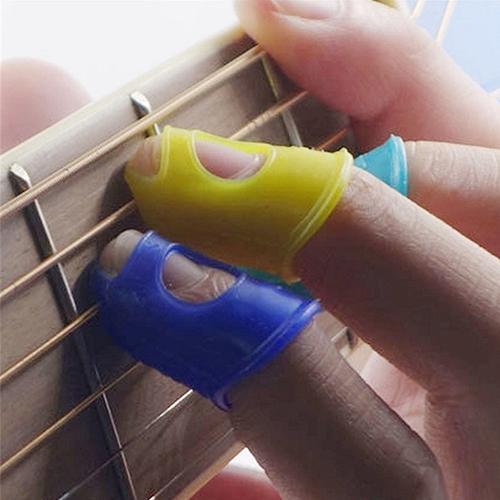 4pcs/set Guitar Silicone Fingertip Protector Gel Finger Guards Guitarra Strings Fingerguards Thumb Finger Nail Protect Cover