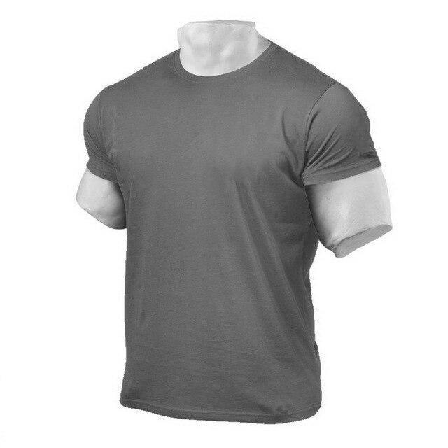 Hommes Sport t-shirt solide entraînement en cours dexécution hauts à manches courtes vêtements de Sport musculation Fitness chemise entraînement gymnase marche Active