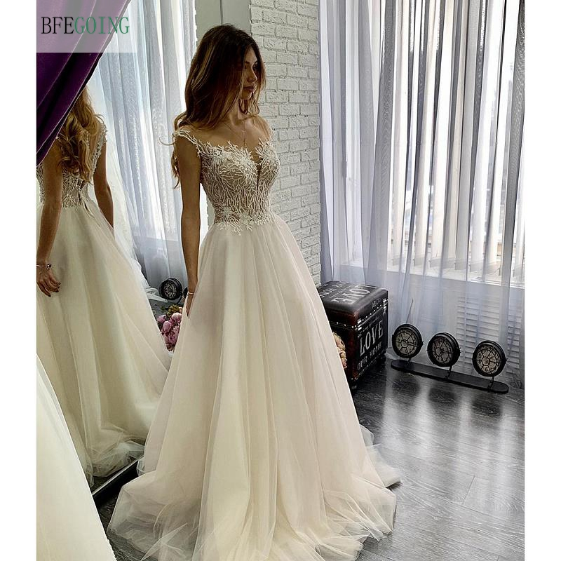 Ivory Tulle Lace Appliques V-Neck Floor-Length Sleeveless  A-line Wedding Dress Sweep/Brush Train Custom Made