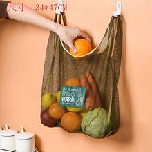 Настенная сумка для хранения имбиря, лука, чеснока, полый дышащий Многофункциональный подвесной мешок, кухонный мешок для хранения, сетчаты...