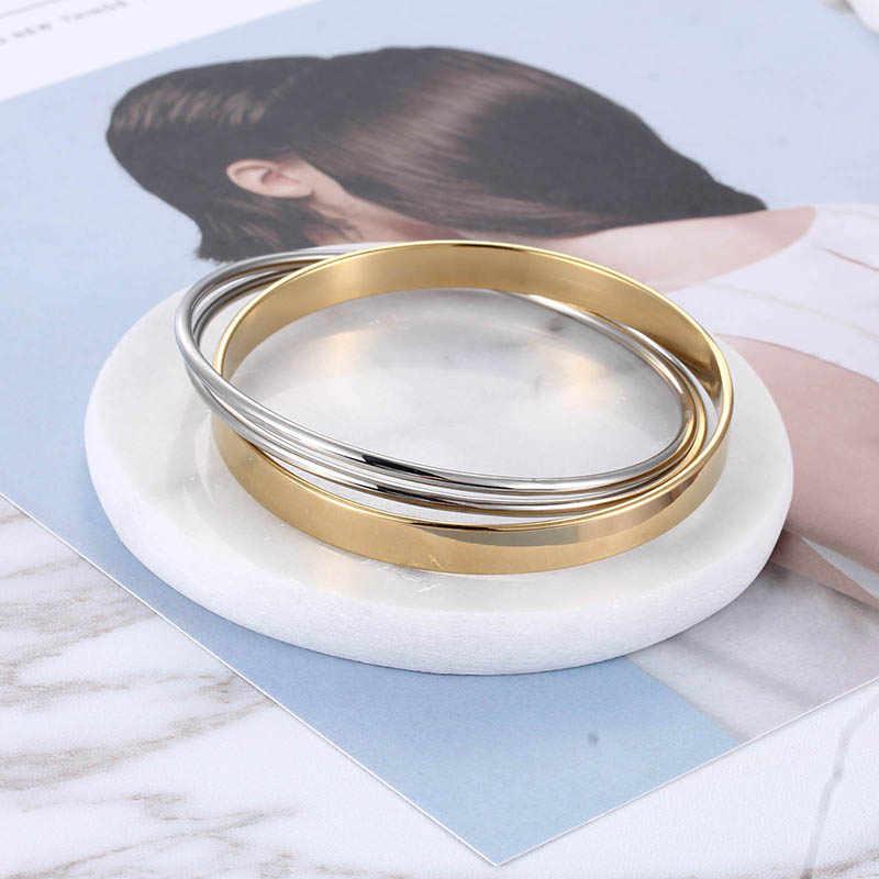 Chaude luxe en acier inoxydable femmes élégant bijoux mode irrégulière trois brillance bracelets femelle or et argent Bracelet ensemble