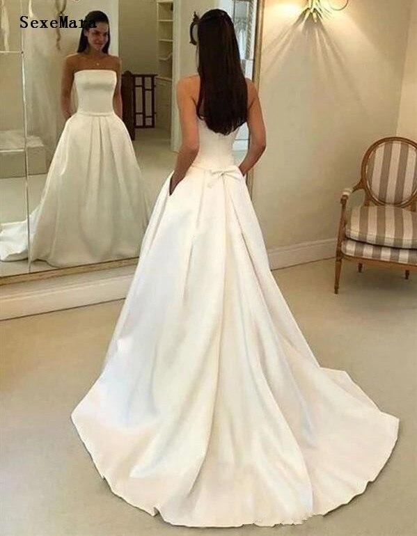Nouveauté une ligne V cou robes de mariée dentelle Appliques avec bouton couvert dos longues robes de mariée sur mesure taille