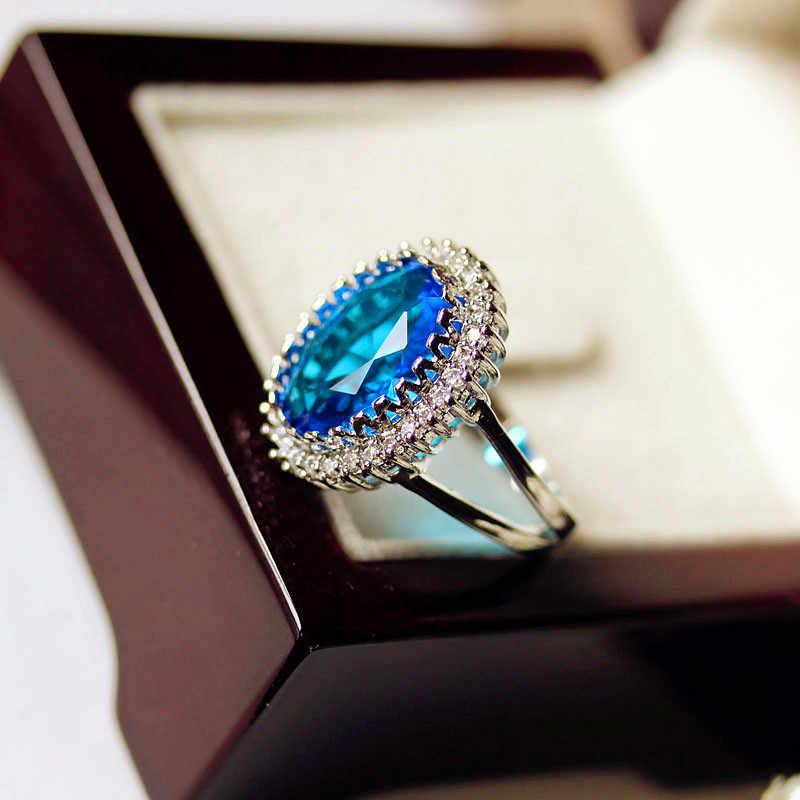 หญิงหรูหราน้ำหินสีฟ้าแหวน 925 เงินสเตอร์ลิงรูปไข่ขนาดใหญ่งานแต่งงานแหวนสัญญารักหมั้นแหวน