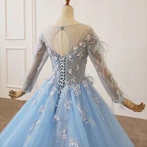 Image 4 - HTL1203 סיום כחול שמלת o צוואר ארוך שרוול נוצת על כתף ומותנים אור טול חצאית שמלת ערב платье выпускное