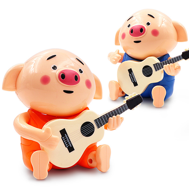 Micro Douyin Hot Selling Three Songs Electric Guitar Seagrass Pigskin Can Sing Rotating Momo Pig