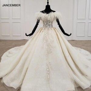 Image 1 - HTL1248 王女のウェディングドレス 2020 毛皮の襟縫製ビーズ上レーススカート背中自由奔放に生きるウェディングロングスリーブ vestido デ noiva