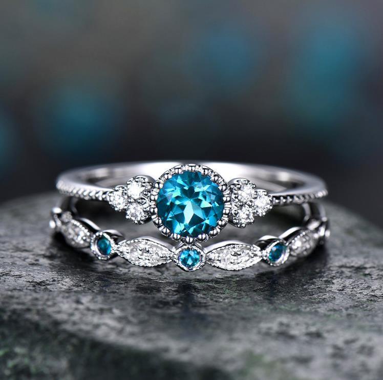 2 шт./компл. кольца Новинка; роскошная женская обувь, расшитая зелеными синий камень кольца с настоящими Австрийскими кристаллами Для женщин серебряного цвета Цвет Свадебные Обручение, модное ювелирное изделие - Цвет основного камня: Lake Blue