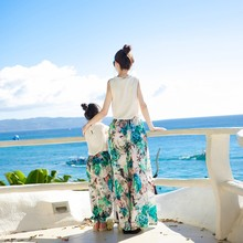Parents and children's summer dress 2020 new style mother and daughter's foreign style leisure pants family dress seaside holida spring and summer new style seaside holiday dress solid color split strap dress open back beach dress