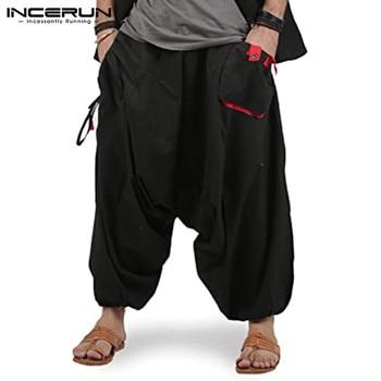 Pantalones caídos de entrepierna a la moda de Color sólido para hombre, Pantalones Harem con cintura elástica, Pantalones holgados con bolsillos, Pantalones casuales para hombre 5XL