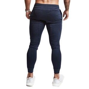 Image 3 - ブランドメンズスポーツランニングパンツ通気性ジョギングパンツスポーツパンツを実行するためのテニスサッカー再生ジムズボンポケット