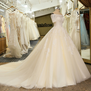 Image 3 - SL 6 Charming Short Sleeve Wedding Gowns Tulle Lace Appliques Vintage Boho Boat Neck Wedding Dress bridal gown suknie slubne