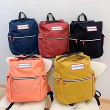 Unisex à prova dunisex água e durável náilon ao ar livre mochila de viagem mochila para portátil com clipe de pára-quedas luz casual mochila de viagem