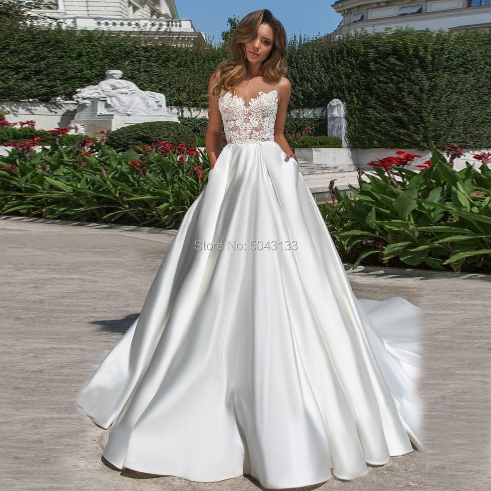 2020 Newest Designed A Line Satin Wedding Dresses Modest Lace Appliques Sheer Neck V Cut Backless Bridal Gown With Pockets Long