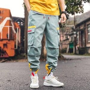 Image 5 - SingleRoad היפ הופ הרמון מכנסיים מטען גברים 2020 צד כיסי מכנסיים רצים Streetwear זכר אופנה מזדמן מכנסי טרנינג Jogger גברים