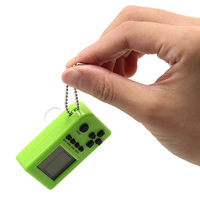 10pcs Kids Gift Tetris Mini Keychain Game Console Handheld Game Player capsule toy twisted egg Built in 26 Games