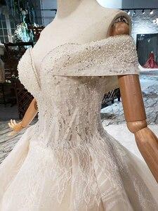 Image 4 - BGW HT43028 Sexy hors de lépaule robe de mariée avec longue Train dentelle Appliques perlée chérie luxe robe de mariée nouvelle arrivée
