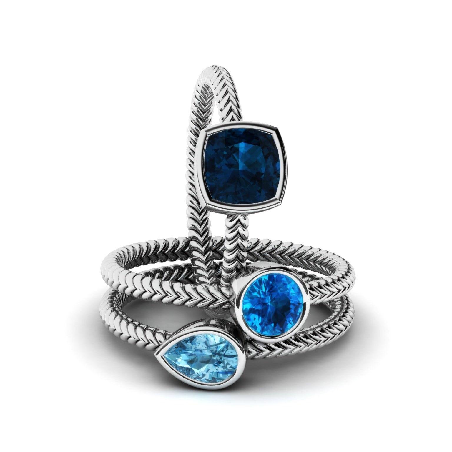 Купить женский набор обручальных колец серебряных с голубым цирконием