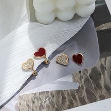 Женские серьги в форме сердца виде золотого винта с розовым