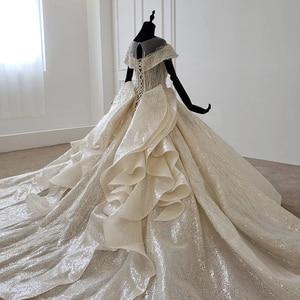 Image 4 - HTL1137 błyszcząca suknia ślubna nakryty rękawem o neck zasznurować gorset suknie ślubne wzburzyć pociąg ins gorąca sprzedaż świecący vestidos novia