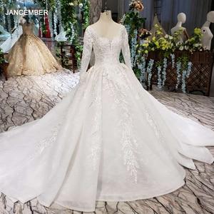 Image 1 - HTL187G פשוט חתונה שמלות ארוך שרוול בעבודת יד פרחי אפליקציות גדול o צוואר שמלת כלה 2020 אופנה חדשה vestido דה noiva