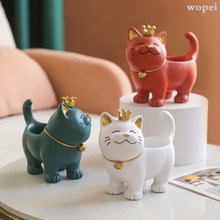 The living room is decorated with resin bowl, crown cat bowl, candy can, golden cat organizer, coffee table and cupboard table.