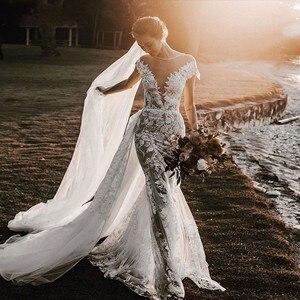 Image 1 - UMK High end Lace Mermaid Wedding Dress 2020 Sexy Backless Short Sleeve Detachable Train Wedding Gowns