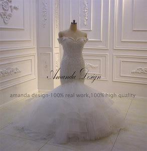 Image 2 - Amanda Design bruidsjurken Off Schulter Spitze Applique Meerjungfrau Hochzeit Kleid