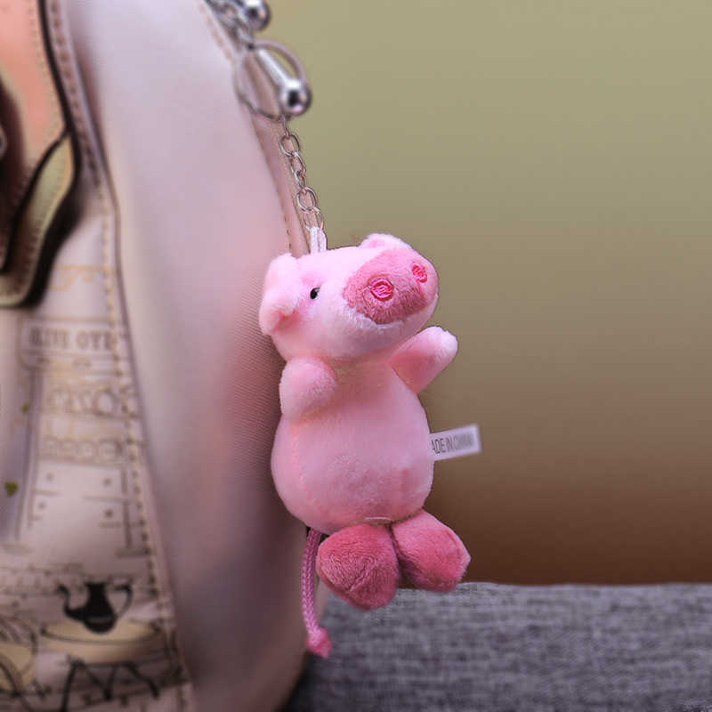 Lindo dibujo de piel Bola de felpa llavero Rosa animal cerdo bolsa colgante llavero soporte niños Chimmy bolso encanto para niños las niñas