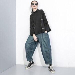 Image 4 - [EAM] 높은 탄성 스플 라이스 포켓 데님 허리 바지 새로운 느슨한 맞는 하렘 바지 여성 패션 조수 봄 가을 2020 1B694