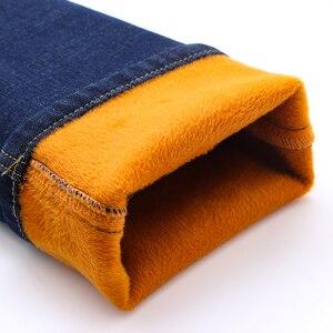 Image 4 - 2020 zima nowy marka męska ocieplane dżinsy dorywczo rozciągliwe dopasowanie spodnie dżinsowe męskie duże rozmiary męskie spodnie 40 42 44 46 czarny niebieski