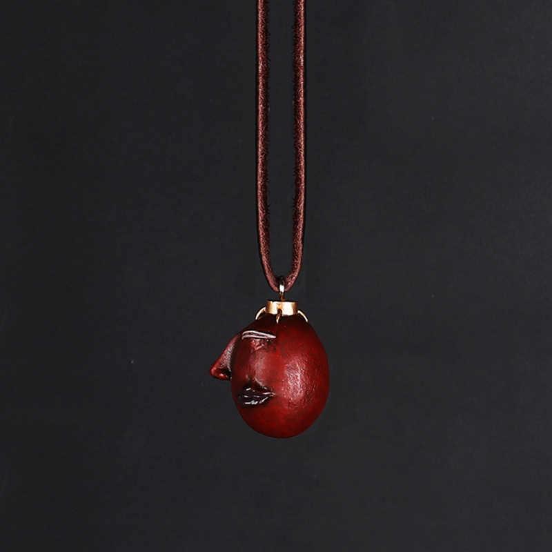 Collier Griffith Berserk Behelit, cramoisi, gousses, l'œuf du roi, Type activé, corde en cuir, 1997