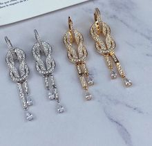 Boucles d'oreilles porte-bonheur en forme de croix, bijoux de marque de luxe, en argent sterling, avec gros diamant, nœud, France
